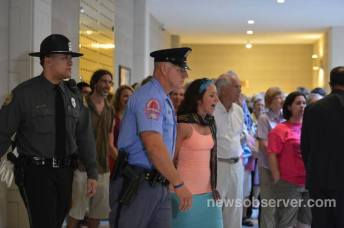 Getting arrested for peaceful protest...protecting what is sacred...in this case equality in North Carolina.